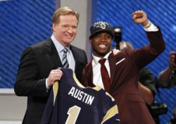 Austin from West Virginia University stands with NFL Commissioner Goodell after being selected by St. Louis Rams as eighth overall pick in the 2013 NFL Draft in New York