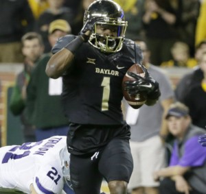Baylor running back Corey Coleman (1) carries the ball as Kansas State's Jonathan Truman (21) and Dylan Schellenberg (20) give chase during an NCAA college football game, Saturday, Dec. 6, 2014, in Waco, Texas. (AP Photo/Tony Gutierrez)
