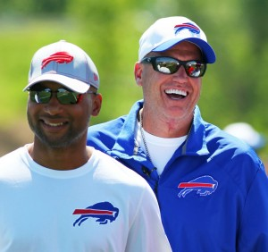 Buffalo GM Doug Whaley and head coach Rex Ryan are dealing with a difficult QB situation. (AP Photo/Bill Wippert)