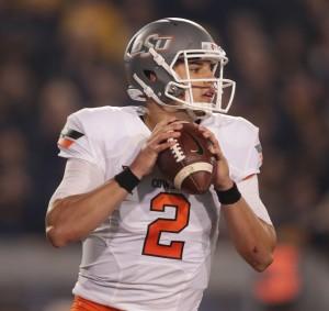 Oklahoma State quarterback Mason Rudolph (2)during the first half/ second half of an NCAA college football game, Saturday, Oct. 10, 2015, in Morgantown, W.Va. (AP Photo/Raymond Thompson)