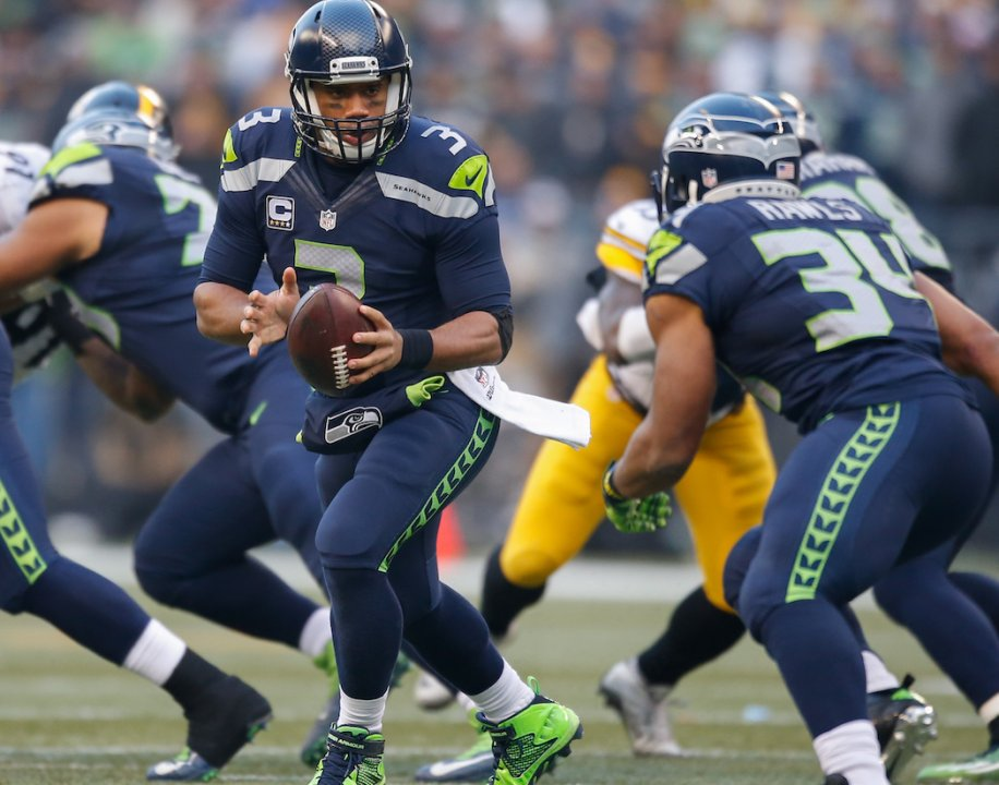 Seattle Wa November 29 Quarterback Rus Wilson 3 Of The Seahawks Looks To Hand Off Running Back Thomas Rawls 34 Against Pittsburgh
