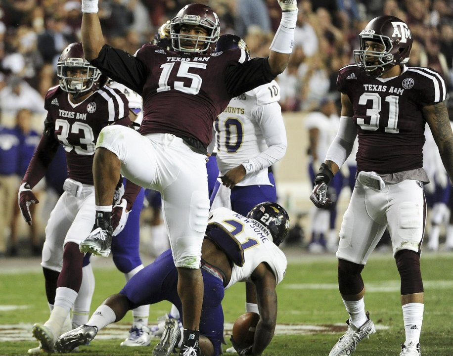 d826b902dd0 COLLEGE STATION, TX - NOVEMBER 14: Myles Garrett #15 of the Texas A&M  Aggies celebrates his tackle of Detrez Newsome #21 of the Western Carolina  ...