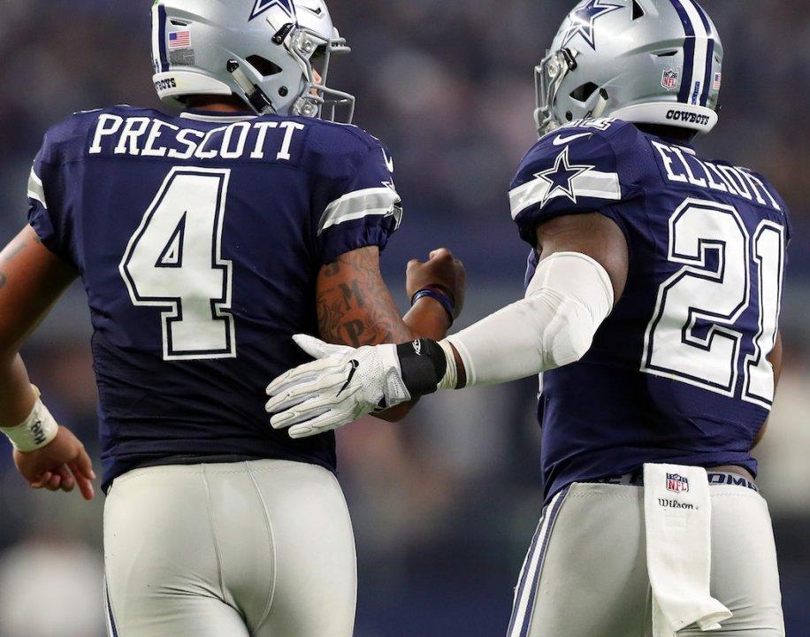 33a124dd98d ARLINGTON, TX - NOVEMBER 24: Dak Prescott #4 of the Dallas Cowboys  celebrates with Ezekiel Elliott #21 after scoring a touchdown during the  fourth quarter ...