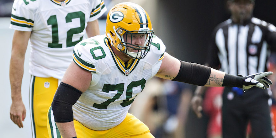 CHICAGO, IL - SEPTEMBER 13: T.J. Lang #70 of the Green Bay Packers prepares to block during a game against the Chicago Bears at Soldier Field on September 13, 2015 in Chicago, Illinois. The Packers defeated the Bears 31-23. (Photo by Wesley Hitt/Getty Images)