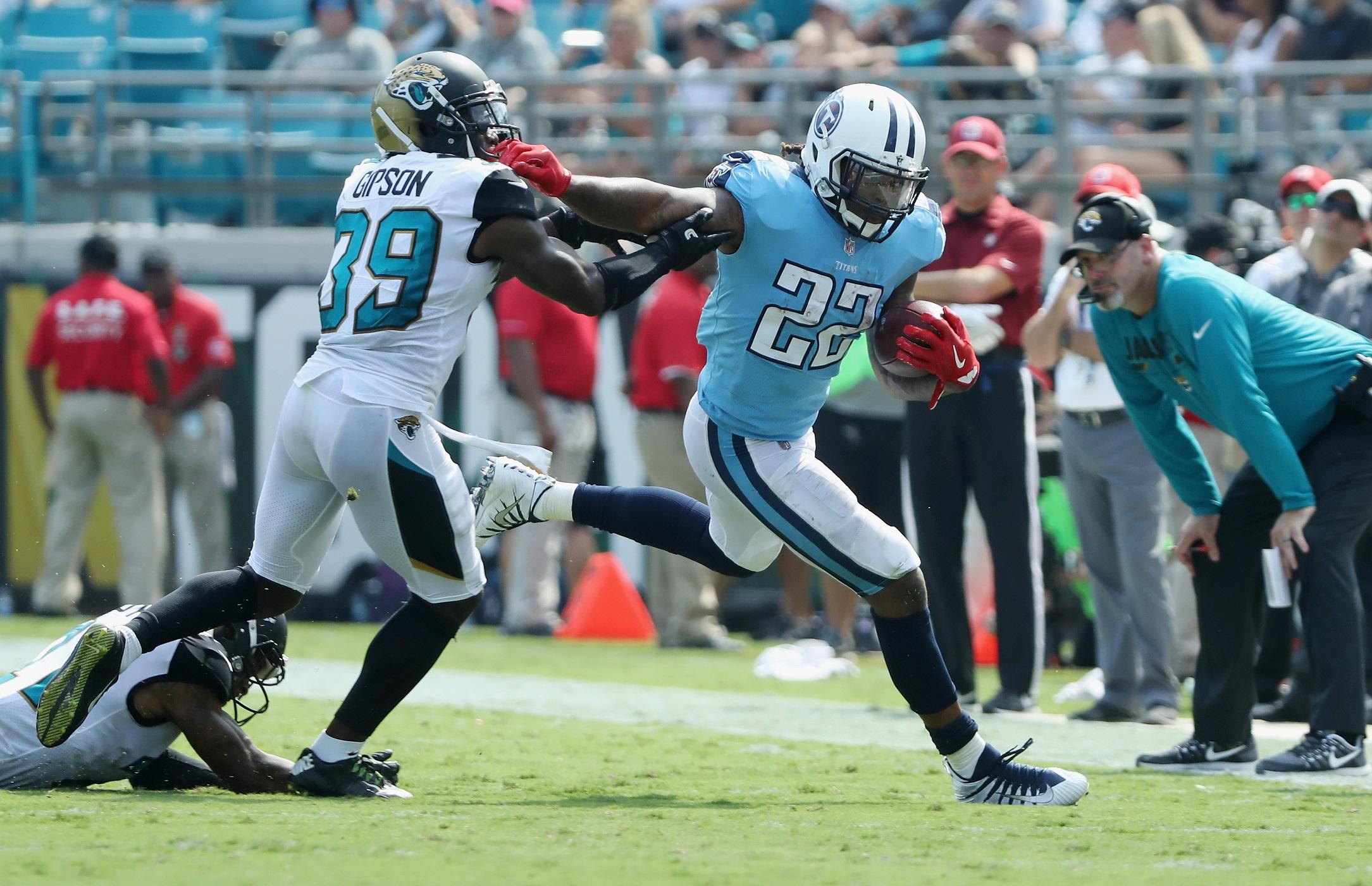 JACKSONVILLE, FL   SEPTEMBER 17: Derrick Henry #22 Of The Tennessee Titans  Runs With The Football Against Tashaun Gipson #39 Of The Jacksonville  Jaguars ...