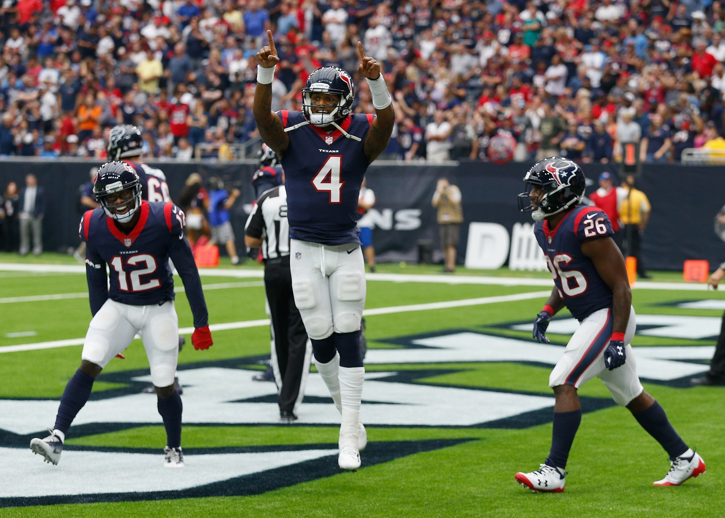 Watson sets record in Texans 57-14 win over Titans