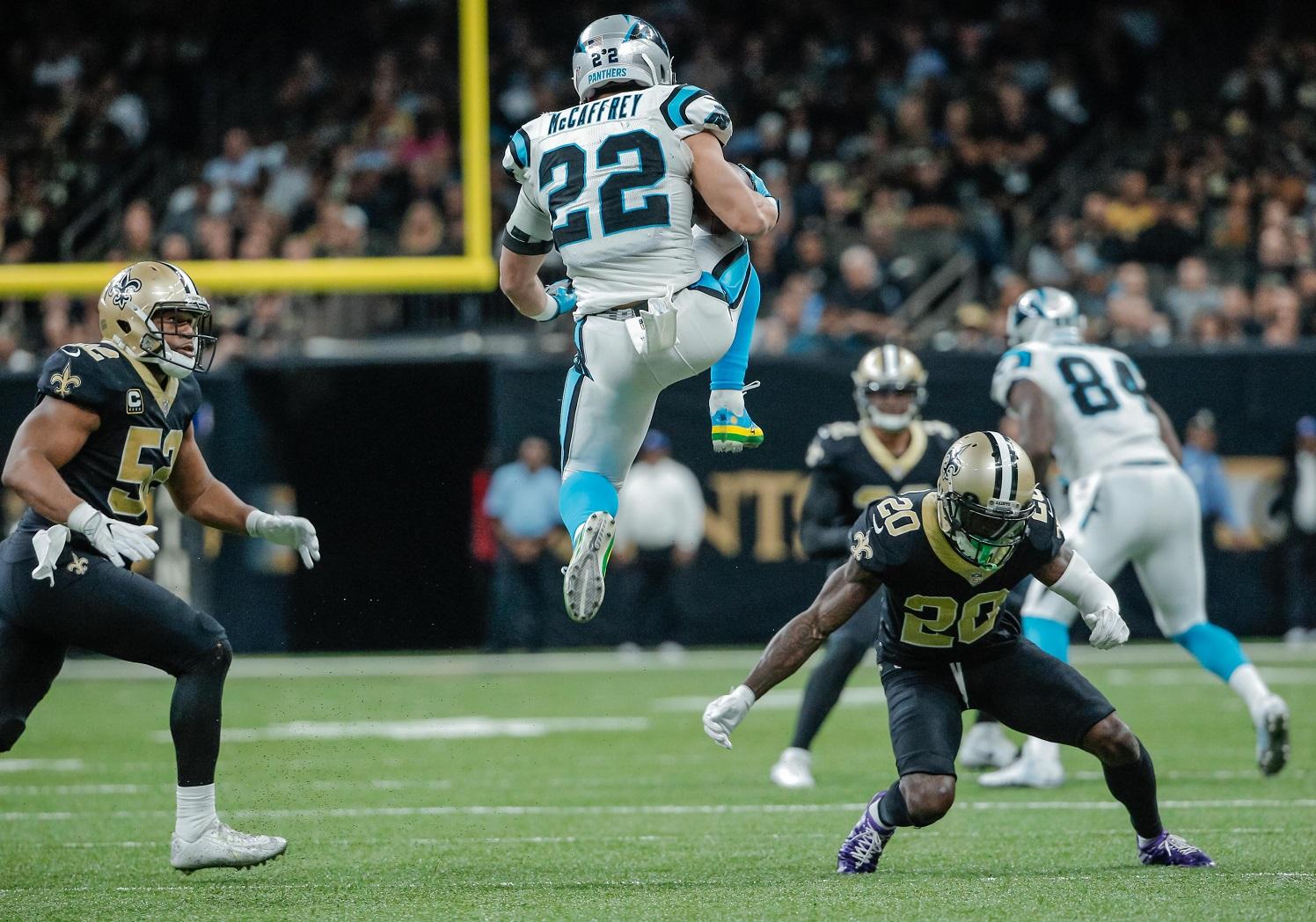 Dec   New Orleans La Usa Carolina Panthers Running Back Christian Mccaffrey  Hurdles New Orleans Saints Cornerback Ken Crawley  During The