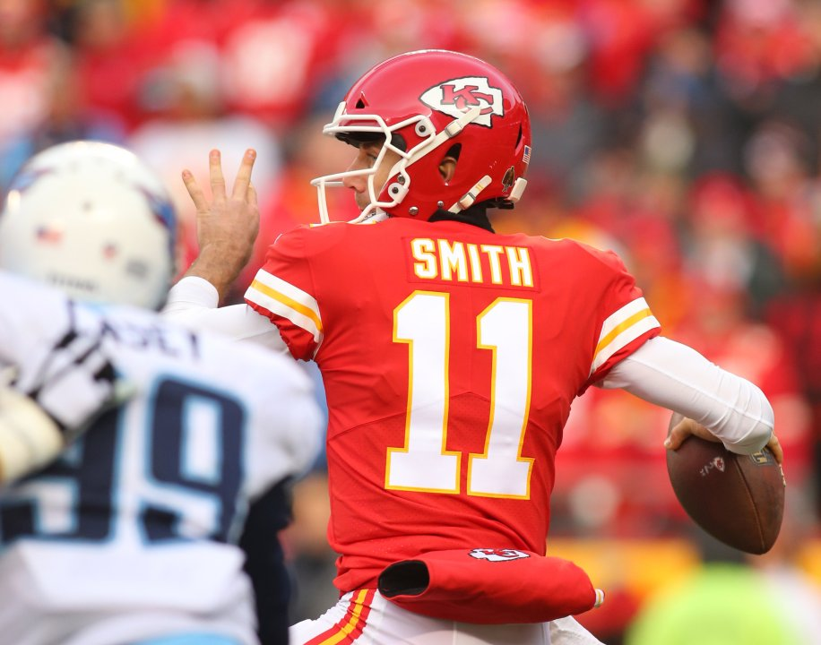 ... Kansas City Chiefs quarterback Alex Smith (11) throws a pass against  the Tennessee Titans during the first quarter in the AFC Wild Card playoff  football ... 16828f525