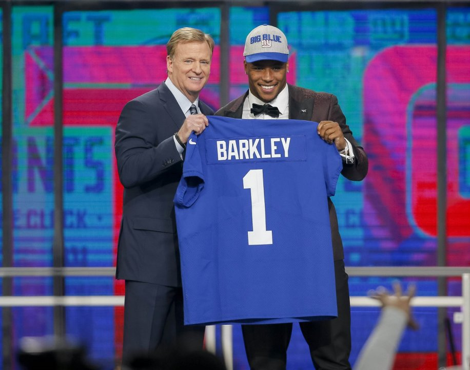 ... Barkley (Penn State) poses with NFL commissioner Roger Goodell after  being selected as the number two overall pick to the New York Giants in the  first ... a669533c1