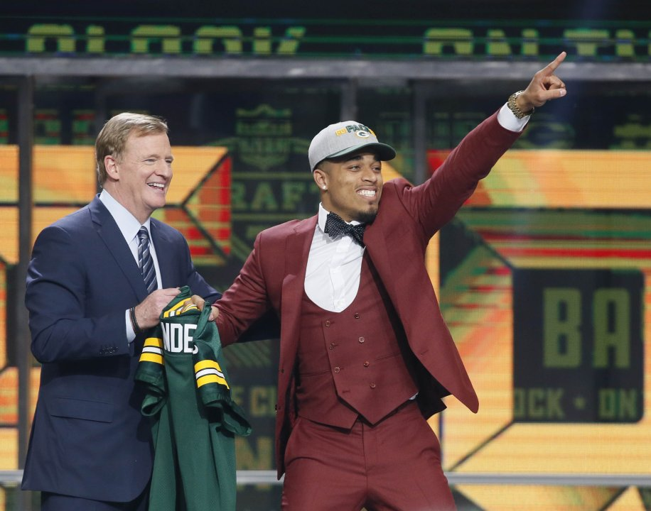 8b72cb0c Apr 26, 2018; Arlington, TX, USA; Jaire Alexander (Louisville) stands with  NFL commissioner Roger Goodell after being selected as the number eighteen  ...