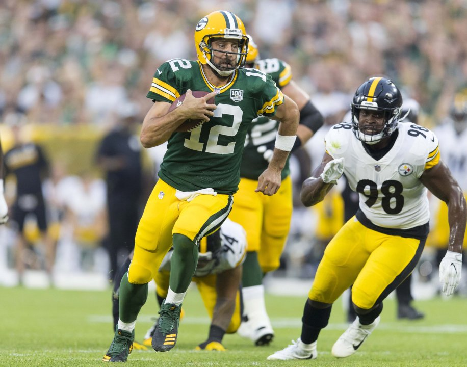 Aug 16 2018 Green Bay WI USA Packers Quarterback Aaron Rodgers 12 Rushes With The Football During First Quarter Against Pittsburgh