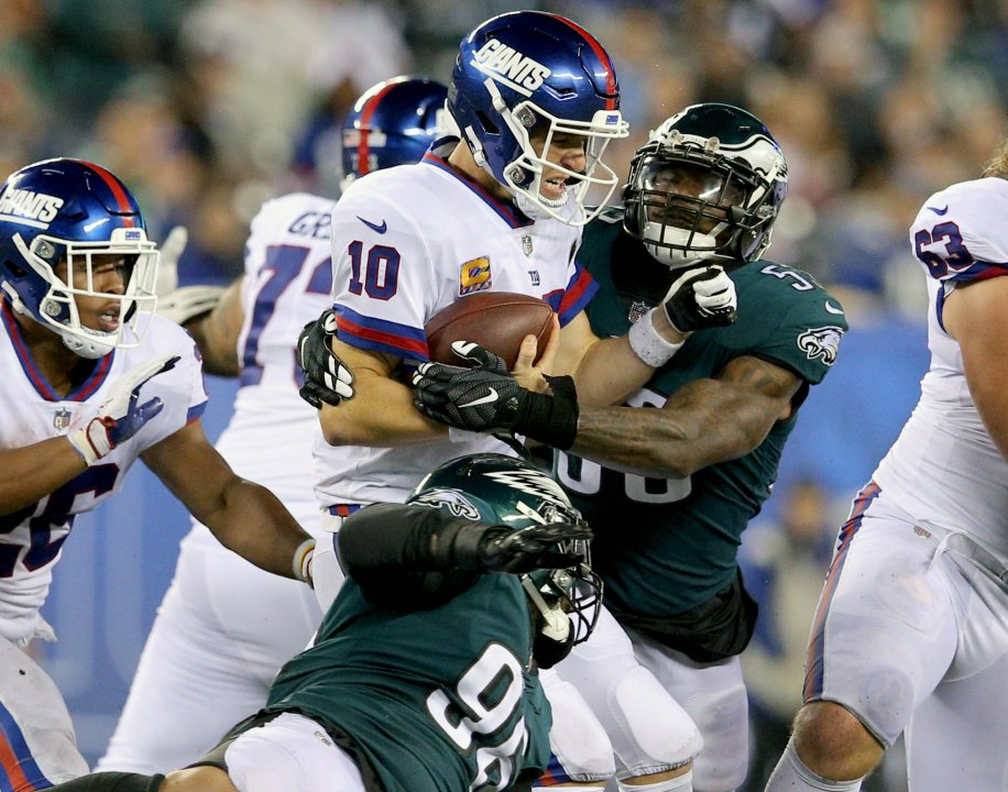 31370c789 ... USA  New York Giants quarterback Eli Manning (10) is sacked by Philadelphia  Eagles linebacker Nigel Bradham (53) during the fourth quarter at MetLife  ...