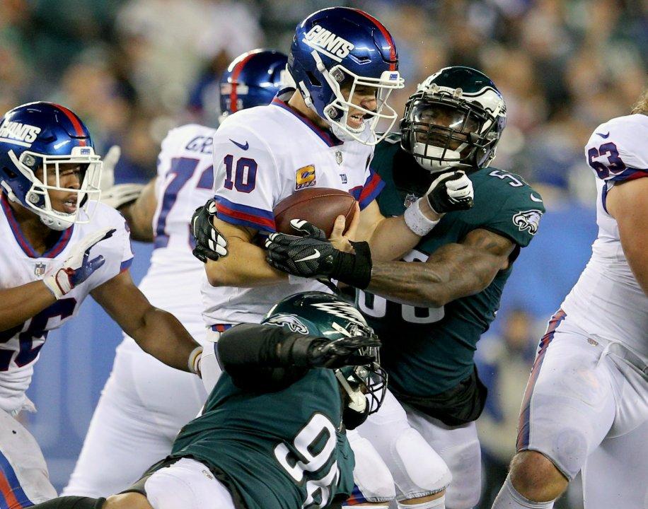 31370c789 ... USA  New York Giants quarterback Eli Manning (10) is sacked by Philadelphia  Eagles linebacker Nigel Bradham (53) during the fourth quarter at MetLife  ...