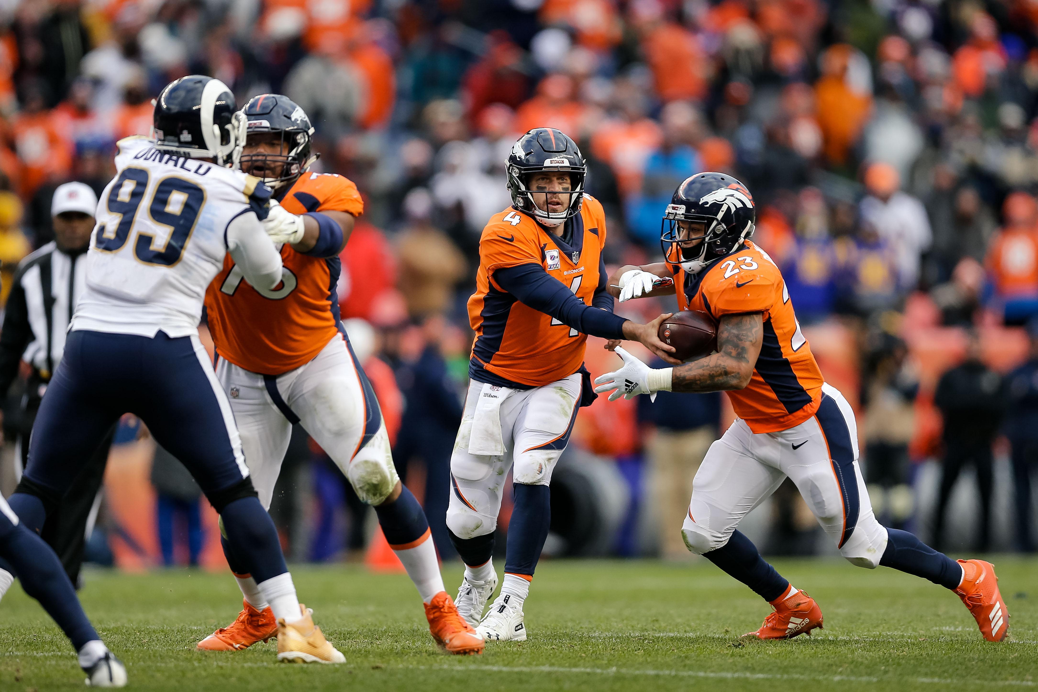 Oct 14 2018 Denver Co Usa Denver Broncos Quarterback Case Keenum 4 Hands The Ball Off To Running Back Devontae Booker 23 As Guard Max Garcia 76