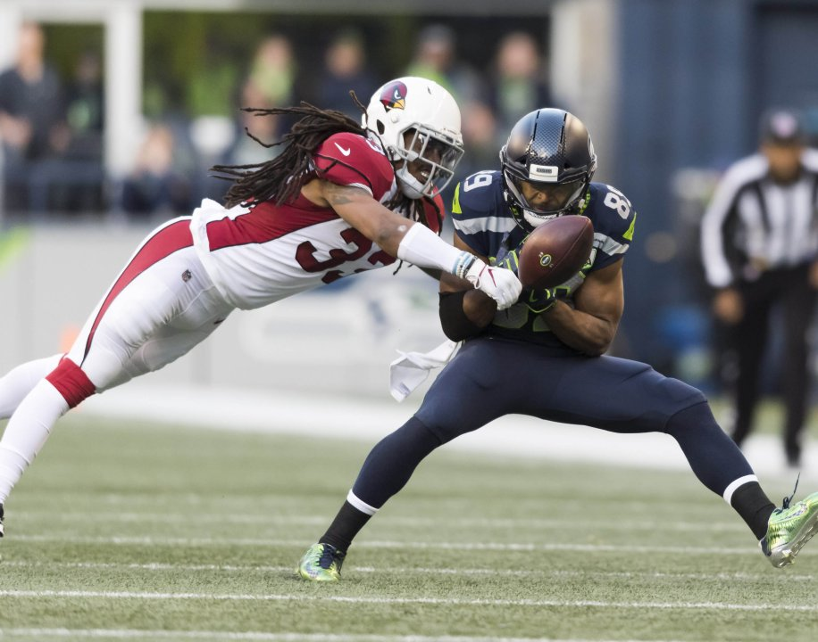 cd9c0625dae Dec 30, 2018; Seattle, WA, USA; Arizona Cardinals defensive back Tre Boston  (33) breaks up a pass intended for Seattle Seahawks wide receiver Doug  Baldwin ...