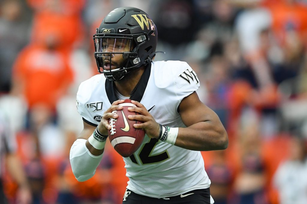 Wake Forest Demon Deacons quarterback Jamie Newman (12) runs with the ball against the Syracuse Orange during the first quarter at the Carrier Dome. Mandatory Credit: Rich Barnes-USA TODAY Sports